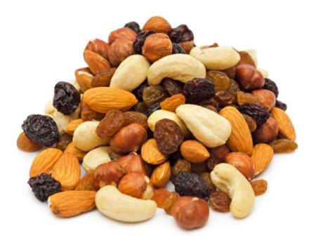 26224153 - mixed nuts and dry fruits pile isolated on white background