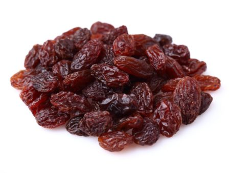 15439302 - dried raisins on a white background